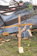 ###Ocala Star-Banner - Day after tornados in the Lake Mack area, Deland, FL### A cross with a Bible rests beside the remains of a mobile home of the late Jamie Wright(cq), age 55, that died along with her fiance Scott Lamond(cq) age 50, in the early Friday morning tornados near Lake Mack. The area is located east of Paisley and west of Deland and just south of Lake County Road 42, Saturday afternoon, Feb. 3, 2007, Deland, FL. ( Jannet Walsh/Star-Banner)2007