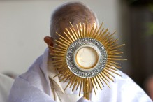 ### Freelance for The Florida Catholic - Dominican Republic trip - CONTACT PHOTOGRAPHER/writer Jannet Walsh 352-598-7976 - cell### Archbishop Ramon Benito de la Rosa y Carpio(cq), of the Archdiocese of Santiago de los Caballeros(cq) displays the monstrance containing consectrated hosts during the celebration of Mass at a Cenacle gathering of bishops, priests religious and faithful. This is part of the Marian Movement of Priests that features Father Stefano Gobbi(cq), of Milan, Italy, who was given the world as his parish by the late Pope John Paul II, with the message to consecrate themselves to the Immaculate Heart of Mary, with the Marian Movement of Priests. Over 4,000 gathered at the open air auditorium called Centro Catolico Carismatico, Saturday morning, March 11, 2006, in Santiago de los Caballeros, Dominican Republic. (Jannet Walsh/Freelance for The Florida Catholic)2006
