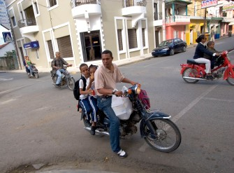 ### Freelance for The Florida Catholic - Dominican Republic trip - CONTACT PHOTOGRAPHER/writer Jannet Walsh 352-598-7976 - cell### Families combine shopping, eating on small motorcycles and scooters as after school in the cool mountain town of Jarabacoa, located 70 miles north of Santo Domingo. Waterfalls is the best know feature of this area, Monday afternoon, March 13, 2006, in Jarabacoa, Dominican Republic. (Jannet Walsh/Freelance for The Florida Catholic)2006