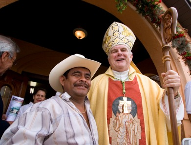 ###First Visit of Bishop Wenski, Ocala, Fla. ###First Visit of Bishop Wenski to Catholic Center Our Lady of Guadalupe and St. Anthony Convent Sergio Flores, left, orginally from Mexico, now of Ocala, poses with Bishop Thomas Wenski after Mass. Flores is wearing a hat very typical of Mexican wear. He started to take his hat off, but the bishop told him to wear his hat also. Diocese of Orlando Bishop Thomas Wenski made his first ever visit to Catholic Center Our Lady of Guadalupe and St. Joseph Convent on Sunday afternoon, March 30, 2008. The convent is home to the Missionary Sisters Catechist, or in Spanish, Hermanas Misioneras Catequistas, that arrived in Ocala on Jan. 30, 2007, from Medell'n, Colombia. This is the religious orderÕs only convent in the United States and officially had their convent blessed and opened April 22, 2007. Bishop Wenski celebrated the Mass with Father Alfonso Cely and Father Patrick Sheedy and Deacon Eddie Berrios, all of Blessed Trinity Catholic Church, Ocala. Father Cely estimated that more than 400 people attended the Mass, packed from wall to wall, with folding chairs. The Tuna La Trinidad de Blessed Trinity, of Ocala, a Spanish style musical band, typical of the European minstrels musicians, performed complete with black capes, serenading the Bishop by the altar and also outside during a luncheon. The to Catholic Center Our Lady of Guadalupe officially opened in 2002. The Catholic Center and convent are both located at 1153 W. State Road 40, Ocala. Prior to 2002, the growing Hispanic communities of mainly Mexicans working in the rural Marion County horse farms were celebrating Mass and services in backyards and at a local horse farm barn prior to the opening of Catholic Center Our Lady of Guadalupe, Sunday afternoon, March 30, 2008, Ocala, Fla. (Jannet Walsh/Freelance to The Florida Catholic)2008