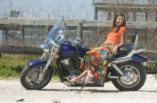 ###OCALA LIFE - Beach fashion at Gator Joe's and Eaton's Beach###Lauren Meyer, 17, Ocala, is Miss Silver Springs for 2004,(dark hair) sitting on a motorcyle on the beach early in the morning at Gator Joe's located on Johnson Beach, on Lake Weir, in Ocklawaha, FL, Saturday, April 4, 2004. The motorcyle is owned by R. J. Miller, of Silver Springs, that was having lunch - with his Honda VTX 1800, circa 2002, with the Southern Cruisers Riding Club. (Jannet Walsh, Star-Banner Photo/NYTRENG).