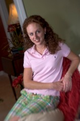 ###Rare Redhead: Danielle Clark, 23, Ocala### Redheaded Danielle Clark, 23, at her home in Ocala. She noted that many people remember her because of her long, curly red hair. Clark is a student at the University of Florida, majoring in recreation event management and also works full time at her family's business Clark Properties, Saturday afternoon, April 9, 2005, Ocala, FL, USA. (Jannet Walsh/Star-Banner)2005