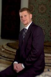 ###Rare Redhead: Jamal Fakhoury, 48, Ocala### Redheaded Dr. Jamal Fakhoury, 48, of Ocala, is a chiropractor by profession. He is originally from the Detroit, Michigan area, but spent part of life growing up in the Middle East. A Muslim by faith, has heritage links to Lebanon from his mother and from Palestine on his father side. Fakhoury has a younger brother Omar Fakhoury, of Ocala, with red hair, including his father, both grandfathers, a grandmother and even a daughter with a signs of auburn red hair. Fakhoury is surrounded by Persian rugs at the Cyrus Rug Gallery, in Ocala, Saturday afternoon, April 9, 2005, Ocala, FL, USA. (Jannet Walsh/Star-Banner)2005