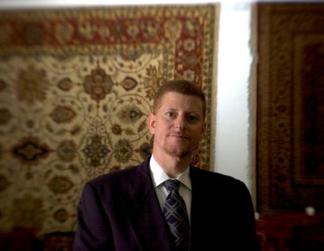 ###Rare Redhead: Jamal Fakhoury, 48, Ocala### Redheaded Dr. Jamal Fakhoury, 48, of Ocala, is a chiropractor by profession. American born, Dr. Fakhoury is originally from the Detroit, Michigan area, but spent part of life growing up in the Middle East. A Muslim by faith, has a family heritage with links to Lebanon from his mother's family and Palestine on his father's side. Fakhoury has a younger brother with red hair, including his father, both grandfathers, a grandmother and even a daughter with a signs of auburn red hair. Fakhoury is surrounded by Persian rugs at the Cyrus Rug Gallery, in Ocala, Saturday afternoon, April 9, 2005, Ocala, FL, USA. (Jannet Walsh/Star-Banner)2005