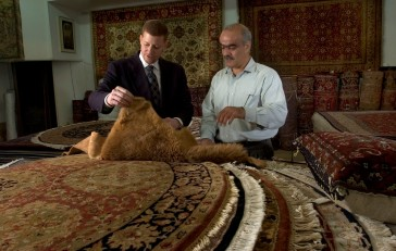 ### Bahram Cyrus Assary (cq) right, owner of the Cyrus Rug Gallery, Ocala### Dr. Jamal Fakhoury (cq) left, of Ocala, a local chiropractor, chats about Persian rugs with Bahram Cyrus Assary (cq), owner of the Cyrus Rug Gallery, Saturday afternoon, April 9, 2005, Ocala, FL, USA. (Jannet Walsh/Star-Banner)2005