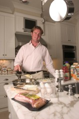 ###OCALA LIFE - Chester Weber at Weir Live Oak home###Chester Weber, a national champion combined driver, makes breakfast at his weekend home called Weir Live Oak, that is a cracker style home, located on the shores of Lake Weir, in Ocklawaha, FL, Saturday, April 10, 2004. (Chester's girlfriend My Larsson (cq) of Stockholm, Sweden are out by the pool and walking on the dock out by the boat house. (Jannet Walsh, Star-Banner Photo/NYTRENG).