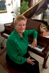 ###Rare Redhead: Carol Ayers, 64, Ocala### Redheaded Carol Ayers, 64, of Ocala, sits at her grand piano at her home. Ayers remembers being teased for her red hair, but learned to take advantage of her out standing red hair as she grew older. She recalls being stared at when she traveling in Taiwan years ago, thinking it might have been the first time for many to see red hair, Monday afternoon, April 11, 2005, Ocala, FL, USA. (Jannet Walsh/Star-Banner)2005