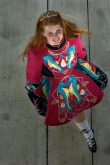 ###Rare Redhead: Ryan Clayton, 16, Ocala### Redheaded Ryan Clayton, 16, of Ocala, wears her Irish step dance solo outfit that is worn at competitions and performances. Clayton, the daughter of Dan and Colleen Clayton, will be a junior at Trinity Catholic High School in the fall, Tuesday afternoon, April 12, 2005, Ocala, FL, USA. (Jannet Walsh/Star-Banner)2005