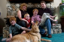 ###Rare Redhead: Michael and LuAnne Warren family of five redheads and red haired dog, Ocala### Redheaded parents LuAnne Warren, 42, and Michael Warren, 36, do their best to sit with their three active red haired boys. Matthew Warren, 8, left, Jonathan, 3, center, and Paul Warren, 6, all have fun with Jenny the Golden Retriever, also a redhead, Monday evening, April 11, 2005, Ocala, FL, USA. (Jannet Walsh/Star-Banner)2005