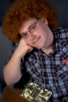 """###Rare Redhead: Peter Prevete, 19, Ocala### Redheaded Peter Prevete, 19, of Ocala, sits with his script for """"Robin Hood"""" at the CFCC theatre. Prevete played the part of """"Friar Tuck"""" in a recent production. He has aproxatimely 2.5 to 3 inch curly hair, but recently had his hair cut for his theatrical role, Wednesday afternoon, April 14, 2005, Ocala, FL, USA. (Jannet Walsh/Star-Banner)2005"""