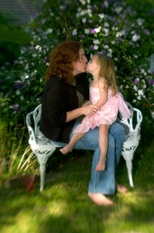 ###Rare Redhead: Brooke Cole, 26, Ocala### Redheaded Brooke Cole, 26, left, gets a kiss from her daughter Symon Cole, 4, with blonde hair, both of Ocala, a garden in the Ocala Historic District. Brooke required additional pain relievers while giving birth to her daughter Symon Cole, now age 4. There is research about redheads that finds them more senitive to pain, Thursday afternoon, April 14, 2005, Ocala, FL, USA. (Jannet Walsh/Star-Banner)2005