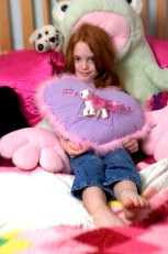 ###Rare Redhead: Riley Grace Mixson, 5, Ocala### Redheaded Riley Grace Mixon, 5, of Ocala, lounges in her bedroom with a few of her favorite pillows and stuffed animals. She is the daughter of Susan and Rick Mixson, Friday afternoon, April 15, 2005, Ocala, FL, USA. (Jannet Walsh/Star-Banner)2005
