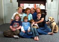 ###Rare Redhead: Family of eight redheads: Russell and Linda Rock, both redheads, and their six redheaded children, of the Florida Highlands### In the beginning there was just Linda Russell, 47, and her husband Russell Rock, 48, both redheads, that married 22 years ago. Russell's red hair has grayed and become darker, with a receding hairline. Today they have six children, all with red hair, with the ages of 8 to 21. The family left right, front row, Wesley Rock, 12; Ian Rock, 10; Olivia Rock, 8 and Caleb Rock, 15, hold the family dog. Back row, left to right: Sam Rock, 21; Linda Rock, 47; Russell Rock, 48, and Nathaniel Rock, 19. The family of redheads all live together, Monday evening, April 25, 2005, Florida Highlands, FL, USA. (Jannet Walsh/Star-Banner)2005
