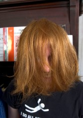 ###Rare Redhead: Family of eight redheads: Russell and Linda Rock, both redheads, and their six redheaded children, of the Florida Highlands### In the beginning there was just Linda Russell, 47, and her husband Russell Rock, 48, both redheads, that married 22 years ago. Russell's red hair has grayed and become darker, with a receding hairline. Here Nathaniel Rock, 19, has a playful redheaded look with his hair in his face. Today they have six children, all with red hair, with the ages of 8 to 21. The family of redheads all live together, Monday evening, April 25, 2005, Florida Highlands, FL, USA. (Jannet Walsh/Star-Banner)2005