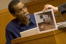 ###Ocala Star-Banner - Fourth day of the trial of Robert Freeman(cq) of Citra, Ocala, FL - Contact photographer at 352-598-7976. Photo Editor Alan Youngblood, 352-598-7967### Robert Freeman(cq) takes the witness stand as he is questioned about the mauling of the late Alice Broom(cq). Here is a photo of the trail Freeman(cq) lived in with 7 pit bull dogs, held up by Candace Hawthorne(cq), defense attorney. The trial of Freeman(cq) is in the court room of Judge Hale Stancil(cq) at the Marion County Courthouse. This is the fourth day of the trial of Robert Freeman(cq), of Citra. Freeman(cq) owned six pit bulls that mauled Alice Broom(cq) to death in front of her home in Citra, in 2003, Thursday afternoon, April 27, 2006, Ocala, FL. ( Photo by Jannet Walsh/Star-Banner)2006