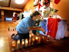"Freelance for The Florida Catholic - Catholic Center Our Lady of Guadalupe - Ocala - PHOTOGRAPHER/writer Jannet Walsh - Rosa Berrios of Ocala, prepares the candles in the shape of the letter ""M"" for Mary in front of the statue of Our Lady of Guadalupe. Berrios' husband Eddie Berrios serves at the deacon at Catholic Center Our Lady of Guadalupe. The Catholic center serves as a church, education center and health clinic located in an area called ""Little Mexico"" in rural Ocala. The center is located close to several area horse farms that employ many Hispanics, many from Mexico, Tuesday evening, June 21, 2005, in Ocala, FL. (Jannet Walsh/Freelance for The Florida Catholic)2005"