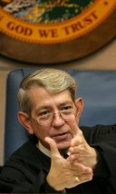 ###NEWS - FLAAS injunction hearing, Ocala- CONTACT PHOTOGRAPHER 352-598-7976 - cell### Judge Jack Singbush (cq) demonstrates with this hands is difficulties of deciding the injunction from case law presented in the injunction hearing of FLAAS has filed to keep the portable classrooms, Thursday evening, July 7, 2005, in Ocala, FL. (Jannet Walsh/Star-Banner)2005