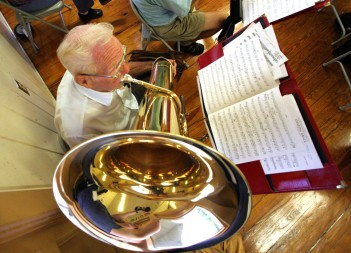 ###NEWS Kingdom of the Sun Concert Band practices at Osceola Middle School, Ocala FL CONTACT PHOTOGRAPHER 352-598-7976 - cell### Vernon Feiler(cq) age 85, of Ocala, started playing a tuba in high school in 1934. Here he plays his Double B Flat tuba with other members of the Kingdom of the Sun Concert Band, Thursday evening, August 4, 2005, Ocala, FL. ( Jannet Walsh/Star-Banner)2005