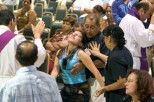 "Ocala Star-Banner - Healing Conference, Ocala, FL.### Father Salomon Bravo of Bogota, Colombia, left, lays his hands on Nohemi Aguirre age 19, of Ocala, that falls backwards as she is receiving a healing. Becoming overwhelmed is called resting in the Holy Spirit, according to Father Alfonso Cely. Aguirre before the healing she was feeling depressed and was at peace and very calm. The event was hosted by the Hispanic Ministry of Blessed Trinity Catholic Church, for the First Grand Charismatic Healing Conference on Sept. 16 and 17, 2006. The theme of ""Christ Heals in Spirit and Truth"" for the many that gathered seeking healing. Speakers included Father Alfonso Cely of Blessed Trinity and Father Salomon Bravo of Bogota, Colombia. The ""Redes"" from Kissimmee and others provided music, Saturday morning, Sept. 16, 2006, Ocala, FL. ( Jannet Walsh/Star-Banner)2006"