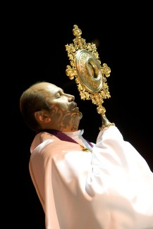 "Ocala Star-Banner - Healing Conference, Ocala, FL. Father Alfonso Cely exposes the monstrance, a vessel that is used for the exposition of the Blessed Sacrament in the species of bread and also known as the host or Eucharist. The event was hosted by the Hispanic Ministry of Blessed Trinity Catholic Church, for the First Grand Charismatic Healing Conference on Sept. 16 and 17, 2006. The theme of ""Christ Heals in Spirit and Truth"" for the many that gathered seeking healing. Speakers included Father Alfonso Cely of Blessed Trinity and Father Salomon Bravo of Bogota, Colombia. The ""Redes"" from Kissimmee and others provided music, Saturday morning, Sept. 16, 2006, Ocala, FL. ( Jannet Walsh/Star-Banner)2006"