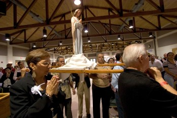 "Ocala Star-Banner - Healing Conference, Ocala, FL. A statue of the Virgin Mary is carried in a the opening procession of an event hosted by the Hispanic Ministry of Blessed Trinity Catholic Church, for the First Grand Charismatic Healing Conference on Sept. 16 and 17 , in Ocala. The theme of ""Christ Heals in Spirit and Truth"" for the many that gathered seeking healing. Speakers included Father Alfonso Cely of Blessed Trinity and Father Salomon Bravo of Bogota, Colombia. The ""Redes"" from Kissimmee and others provided music, Saturday morning, Sept. 16, 2006, Ocala, FL. ( Jannet Walsh/Star-Banner)2006"