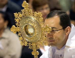 "###Ocala Star-Banner - Healing Conference, Ocala, FL.### Father Salomon Bravo(cq) of Bogota, Colombia, carries a monstrance, a vessel that is used for the exposition of the Blessed Sacrament in the species of bread and also known as the host or Eucharist. This was part of opening procession of an event hosted by the Hispanic Ministry of Blessed Trinity Catholic Church, for the First Grand Charismatic Healing Conference on Sept. 16 and 17 , in Ocala. The theme of ""Christ Heals in Spirit and Truth"" for the many that gathered seeking healing. Speakers included Father Alfonso Cely(cq) of Blessed Trinity and Father Salomon Bravo(cq) of Bogota, Colombia. The ""Redes"" from Kissimmee and others provided music, Saturday morning, Sept. 16, 2006, Ocala, FL. ( Jannet Walsh/Star-Banner)2006"