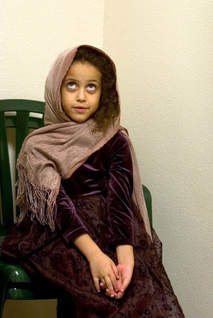 ###Ocala Star-Banner - Ramadan 2005, evening breaking of fast party Saturday, Oct. 22, 2005, Ocala, FL.### Islam project: Katya Bonthron(cq) of Ocala, was age 7 at the time of Ramadan 2005, gets ready for prayer. The breaking of fasting party, during the holy month of Ramadan in 2005, that involves the fasting of food during the day. The Islamic Center of Ocala, located on Northeast 14th Street, celebrated the evening of Saturday, Oct. 22, 2005 with a party hosted by Dr Humeraa Qamar(cq) and her husband Dr. Asad Qamar(cq) of Ocala, that included food, prayer, fellowship. In the prayer rooms, men and women are separated by a white curtain, the faithful gather for one of the times of daily prayer, Saturday evening, October 22, 2005, Ocala, FL. ( Jannet Walsh/Star-Banner)2006