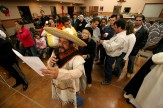 "Ocala Star-Banner - Advent: Our Lady of Guadalupe Catholic Center, known in Spanish as La Guadalupna, Advent celebrations, Ocala, FL - Fernando Veloz of Ocala, wearing a large Mexican hat, leads songs of Our Lady of Guadalupe about 2:30am Monday. An estimated 700 people attended a special Advent program, the four weeks prior to Christmas, starting shortly after midnight on Monday, Our Lady of Guadalupe Catholic Center, and also known in Spanish as La Guadalupna, located at 11153 W. State Road 40, in the ""Little Mexico"" area of rural horse farms, awaited the arrival of the Los Caporales Mariachi, of Tampa. The celebration or feast day of the patroness of the center Our Lady of Guadalupe is traditionally celebrated in Mexico with a serenade starting just after midnight on December 12, according to Father Cely, with the Hispanic Ministry of Blessed Trinity Catholic Church. Father Cely ministers to a many Mexican parish at Our Lady of Guadalupe with special celebrations and customs from Mexico. Nine days of special prayers, Masses, recitation of the Rosary, started the special Advent program that is of Mexican origin for Our Lady of Guadalupe, Monday morning, December 12, 2005, Ocala, FL. ( Jannet Walsh/Star-Banner)2005"