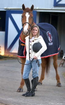 ###Ocala Star-Banner - Megan Massaro(cq) age 17 of Belleview, at Don Stewart Stables, Reddick, FL CONTACT PHOTOGRAPHER 352-598-7976 ### Megan Massaro(cq) age 17 of Belleview, at Don Stewart Stables, with Apollo, Tuesday afternoon, December 13, 2005, Reddick, FL. ( Jannet Walsh/Star-Banner)2005