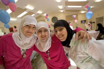 Layla Aysheh, 14, left, sister Yesmean Ayshen, 12, center and their friend Reham, 14, all of Ocala, proudly wear their hijabs at the end of the year party for Arabic language students and a hijab party for the three young women who are taking on wearing hijabs permanently. - JANNET WALSH/STAR-BANNER, 2006