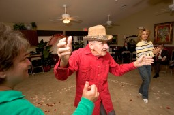 ###Ocala Star-Banner, Seniors Valentine's Ball at Hampton Manor, Belleview, FL - contact photographer at 352-598-7976### Lloyd Baldini(cq) age 79, right, resident, dances with his daughter Kathy Stafford(cq), of The Villages, at the Valentine's Ball complete with music and rose petals on the dance floor at Hampton Manor, Tuesday evening, Feb. 14, 2006, Belleview, FL. ( Jannet Walsh/Star-Banner)2006