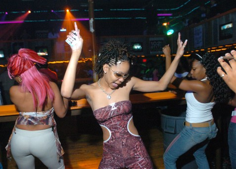 ##Graffiti Beach## Crystal Goadson, 21, of Ocala, center, dances to the hip hop music at Graffiti Beach as she holds on tighly to her identification card, Thursday evening, Feb. 17, 2005, Ocala, FL. (Jannet Walsh/Star-Banner)2005
