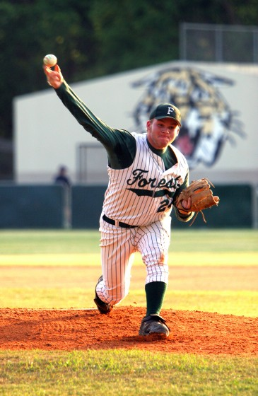 ###Forest High School vs. Gainesville High School at old Forest baseball field###Forest High School's Doug Stickley (24), pitches in the opening of the game against Gainesville High School in a district tournament game, Thursday evening, April 21, 2005, Ocala, FL, USA. (Jannet Walsh/Star-Banner)2005