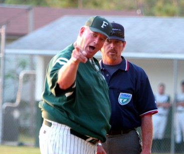 ###Forest High School vs. Gainesville High School at old Forest baseball field###Forest High School's coach Wayne Yancy, left, argues a play in favor of his player that was out at third base in a game against Gainesville High School in a district tournament game, Thursday evening, April 21, 2005, Ocala, FL, USA. (Jannet Walsh/Star-Banner)2005