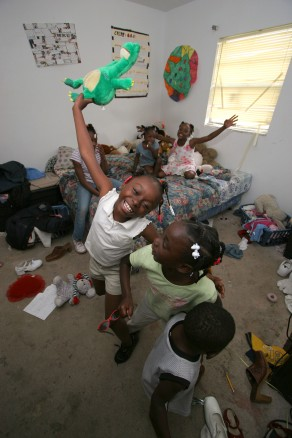 ###Habitat House for family###Kateria Bostick, 7, front with a green stuffed animal, Tianna Bostick, 6, front center and Edward Johnson Jr., age 1 year. On bed left to right are Toni Sands, 11, left, Edmanni Johnson, 4, center and Tekeiyah Sands, 9. The six children all sleep on the bed together. Not pictured is a stepsister Madonna Lee, age 16. The children and their parents Kateius and Edward Johnson will all be moving into a Habitat for Humanity house on Mother's Day. The new house is located at 1323 Southwest Fort King Street, Friday afternoon, May 6, 2005, Ocala, FL, USA. (Jannet Walsh/Star-Banner)2005