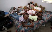 ###Habitat House for family###Six children share one bed, two twin size beds pushed together. The children and their parents Kateius and Edward Johnson will all be moving into a Habitat for Humanity house on Mother's Day. The new house is located at 1323 Southwest Fort King Street, Friday afternoon, May 6, 2005, Ocala, FL, USA. (Jannet Walsh/Star-Banner)2005