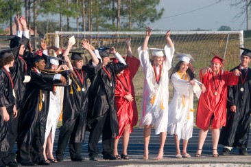 ###Ocala Star-Banner - Dunnellon High School graduation at Dunnellon High School Football Stadium, Dunnellon FL - Contact photographer at 352-598-7976. Photo Editor Alan Youngblood, 352-598-7967### Students do the wave as they wait for the start of the procession at the graduation at Dunnellon High School at Dunnellon High School Football Stadium, Friday evening, May 19, 2006, Dunellon, FL. ( Photo by Jannet Walsh/Star-Banner)2006