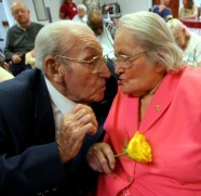 "####Pauline and Earl Raub celebrating 80th wedding anniversary at Avante Nursing and Rehab Center, Leesburg##Earl Raub, 96, and wife Pauline Raub, 95, both of Weirsdale, but Pauline currently is a resident of Avante Nursing and Rehab Center in Leesburg. Here the couple kiss at their 80th wedding anniversary with singing by Bob Rodgers, of Ocala. Their daughter Paulina Maxson, (cq) 77, of Weirsdale, was on hand for the celebration. The couple is possibly the oldest known current married couple in the United States, and possibly second to a couple in England. When asked how long they have been married, Pauline state, ""It's been a long time gone."" Sunday afternoon, June 5, 2005, Leesburg, FL, USA. (Jannet Walsh/Star-Banner)2005"