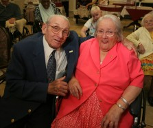 "####Pauline and Earl Raub celebrating 80th wedding anniversary at Avante Nursing and Rehab Center, Leesburg##Earl Raub, 96, and wife Pauline Raub, 95, both of Weirsdale, but Pauline currently is a resident of Avante Nursing and Rehab Center in Leesburg. Here the couple is all smiles after sharing a kiss at their 80th wedding anniversary with singing by Bob Rodgers, of Ocala. Their daughter Paulina Maxson, (cq) 77, of Weirsdale, was on hand for the celebration. The couple is possibly the oldest known current married couple in the United States, and possibly second to a couple in England. When asked how long they have been married, Pauline state, ""It's been a long time gone."" Sunday afternoon, June 5, 2005, Leesburg, FL, USA. (Jannet Walsh/Star-Banner)2005"