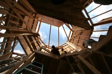 ###NEWS - Golden Ocala construction - Ocala - CONTACT PHOTOGRAPHER 352-598-7976 - cell### Andres Segura (cq) center, with New Phase Construction, an Ocala framing business, works on the 29 foot stair tower. The home is being built for Derrick Kelly (cq) , by Luetgert Development, general contractor, with 5,737 square feet living under air conditioning and 7,950 square feet total living, Tuesday morning, June 21, 2005, in Ocala, FL. (Jannet Walsh/Star-Banner)2005