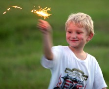 "###NEWS - The Jaycees God and Country Day, Ocala - CONTACT PHOTOGRAPHER 352-598-7976 - cell### James ""Bo"" McGraw (cq) age 5, of Anthony, plays with a sparkler before the fireworks started at the Golden Hills Golf and Turf Club, located on U.S. 27, about four miles west of Interstate 75, Monday evening, July 4, 2005, in Ocala, FL. (Jannet Walsh/Star-Banner)2005"