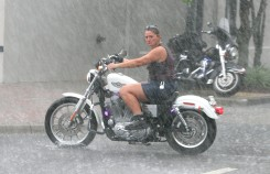 ###NEWS - 2005 Ocala Sturgis Rally, Ocala CONTACT PHOTOGRAPHER 352-598-7976 - cell### A motorcyclist looks for a place to park in rain and thunder storm. The 2005 Ocala Sturgis Rally, with many motorcycles on display around the Ocala downtown square, even in the rain, Friday evening, July 29, 2005, Ocala, FL. ( Jannet Walsh/Star-Banner)2005