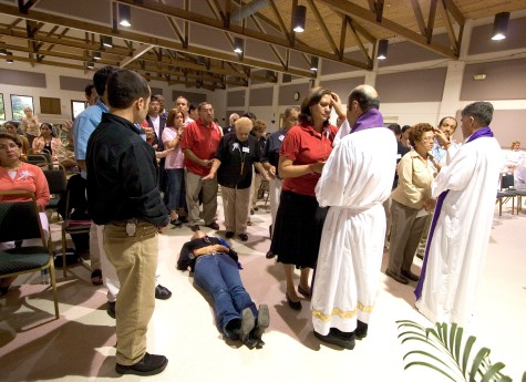 """###Ocala Star-Banner - Healing Conference, Ocala, FL.### Maria Diaz(cq) of Clermont, lays on the floor as she rests in the Holy Spirit after she received a healing. She doing a healing by proxy for a family member that is very ill. Becoming overwhelmed is called resting in the Holy Spirit, according to Father Alfonso Cely(cq). Aguirre(cq) before the healing she was feeling depressed and was at peace and very calm. The event was hosted by the Hispanic Ministry of Blessed Trinity Catholic Church, for the First Grand Charismatic Healing Conference on Sept. 16 and 17, 2006. The theme of """"Christ Heals in Spirit and Truth"""" for the many that gathered seeking healing. Speakers included Father Alfonso Cely(cq) of Blessed Trinity and Father Salomon Bravo(cq) of Bogota, Colombia. The """"Redes"""" from Kissimmee and others provided music, Saturday morning, Sept. 16, 2006, Ocala, FL. ( Jannet Walsh/Star-Banner)2006"""